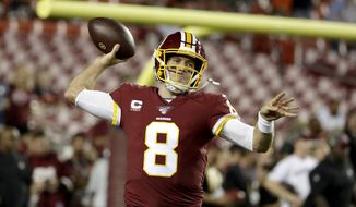 Washington Redskins quarterback Case Keenum warms up prior to an NFL football game against the Chicago Bears Monday, Sept. 23, 2019, in Landover, Md. (AP Photo/Julio Cortez)