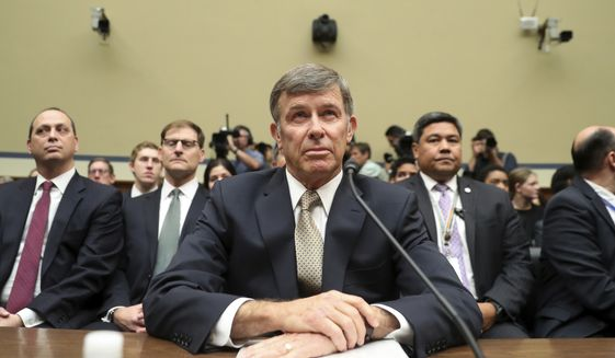 Acting Director of National Intelligence Joseph Maguire takes his seat before testifying before the House Intelligence Committee on Capitol Hill in Washington, Thursday, Sept. 26, 2019. (AP Photo/Andrew Harnik)