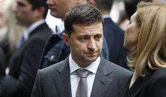 Ukraine President Volodymyr Zelensky visits the site of the 9/11 terror attacks at ground zero in New York, Thursday, Sept. 26, 2019. Zelensky made specific stops at the names of victims that were born in Ukraine. (AP Photo/Seth Wenig)