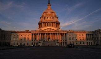 The rising sun divides the West Front of the U.S. Capitol in Washington, Wednesday morning, Sept. 25, 2019, the day after Speaker of the House Nancy Pelosi, D-Calif., declared she will launch a formal impeachment inquiry against President Donald Trump. (AP Photo/J. Scott Applewhite)