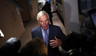 European Union chief Brexit negotiator Michel Barnier talks to journalists before a Brexit Steering Group meeting at the European Parliament in Brussels, Thursday, Sept. 26, 2019. (AP Photo/Francisco Seco)