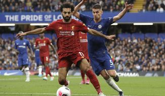 Liverpool's Mohamed Salah, left, and Chelsea's Jorginho compete for the ball during the British premier League soccer match between Chelsea and Liverpool, at the Stamford Bridge Stadium, London, Sunday, Sept. 22, 2019. (AP Photo/Matt Dunham)