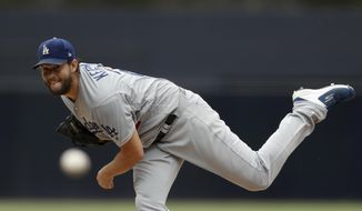 Los Angeles Dodgers starting pitcher Clayton Kershaw works against a San Diego Padres batter during the first inning of a baseball game Thursday, Sept. 26, 2019, in San Diego. (AP Photo/Gregory Bull)