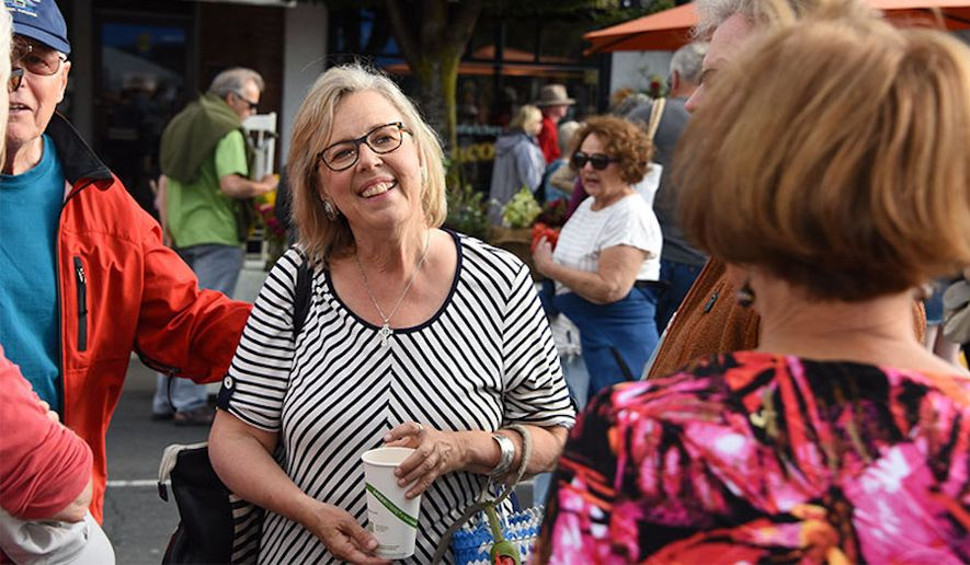 Canada's Green Party has admitted to editing a photo of party leader Elizabeth May to make it look like she's holding a reusable cup when she was really holding a single-use cup. (Green Party of Canada)