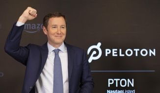 Peloton CEO John Foley celebrates at the Nasdaq MarketSite before the opening bell and his company's IPO, Thursday, Sept. 26, 2019 in New York. (AP Photo/Mark Lennihan)