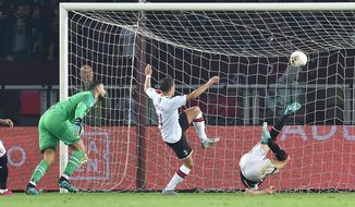 Torino's Andrea Belotti, right,  scores the goal during the Italian Serie A soccer match between Torino FC and AC Milan at the Olimpico Grande Torino stadium in Turin, Italy, Thursday, Sept. 26 2019. (Alessandro Di Marco/ANSA via AP)