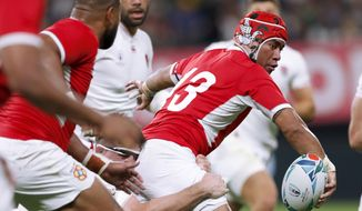 Tonga's Siale Piutau (13) makes a pass during the Rugby World Cup Pool C game between England and Tonga at Sapporo Dome in Sapporo, northern Japan, Sunday, Sept. 22, 2019. (Juntaro Yokoyama/Kyodo News via AP)