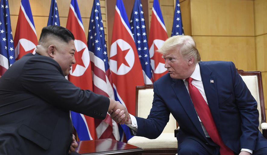 """In this June 30, 2019, file photo, U.S. President Donald Trump, right, meets with North Korean leader Kim Jong-un at the border village of Panmunjom in the Demilitarized Zone, South Korea. North Korea on Friday, Sept. 27, 2019, says it wants Trump to make a """"wise option and bold decision"""" to produce a breakthrough in stalled nuclear diplomacy. (AP Photo/Susan Walsh, File)"""