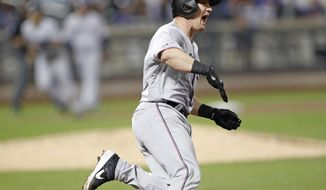 Miami Marlins' Tyler Heineman reacts after hitting a two-run home run during the eighth inning of a baseball game against the New York Mets, Thursday, Sept. 26, 2019, in New York. (AP Photo/Kathy Willens)