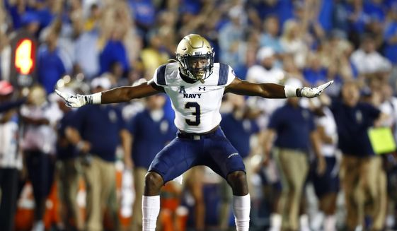 Navy special teams defender Cameron Kinley celebrates a missed field goal by Memphis during an NCAA college football game in Memphis, Tenn., Thursday, Sept. 26, 2019. (Joe Rondone/The Commercial Appeal via AP) **FILE**