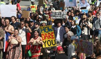 Thousands of people march on Parliament to protest climate change in Wellington, New Zealand, Friday, Sept. 27, 2019. The protest in New Zealand was part of a second wave of protests around the world as the United Nations General Assembly met in New York. (AP Photo/Nick Perry) ** FILE **