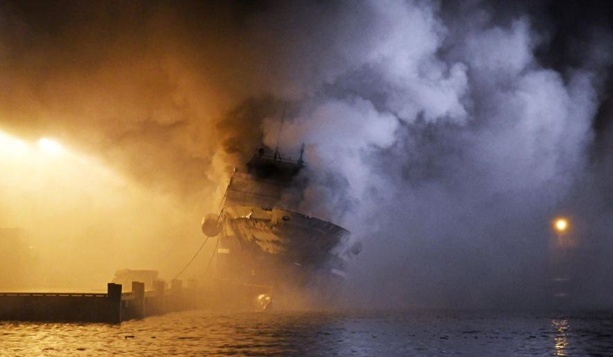 The Russian fishing trawler Bukhta Naezdnik engulfed in flames in the harbour of Tromso, Norway, Thursday Sept. 26, 2019. (Rune Stoltz Bertinussen/NTB Scanpix via AP)