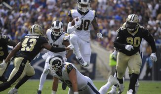 Los Angeles Rams running back Todd Gurley jumps over offensive tackle Rob Havenstein during the second half of an NFL football game against the New Orleans Saints Sunday, Sept. 15, 2019, in Los Angeles. (AP Photo/Mark J. Terrill)