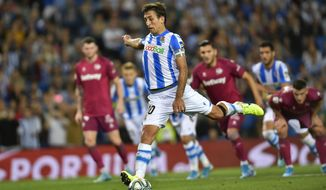 Real Sociedad's Mikel Oyarzabal, kicks the ball to score the third for his team during the Spanish La Liga soccer match between Real Sociedad and Alaves at Reale Arena stadium, in San Sebastian, northern Spain, Thursday, Sept. 26, 2019. (AP Photo/Alvaro Barrientos)