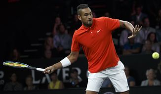 Team World's Nick Kyrgios serves a ball to Team Europe's Roger Federer during their match at the Laver Cup tennis event in Geneva, Switzerland, Saturday, Sept. 21, 2019. (Salvatore Di Nolfi/Keystone via AP)