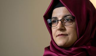 "Hatice Cengiz, the fiancee of murdered Saudi journalist Jamal Khashoggi, listens to a question during an interview Thursday, Sept. 26, 2019, in New York. ""My purpose is to concentrate on what else could be done to enable justice for Jamal,"" Cengiz said. ""And that's why I keep attending various events to make Jamal's voice heard. And, of course, nothing will bring Jamal back. For this reason, my aim is to also give a voice to thousands of prisoners in Saudi Arabia."" (AP Photo/Craig Ruttle)"
