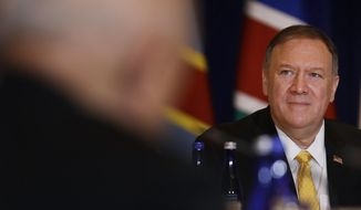 U.S. Secretary of State Mike Pompeo listens during an event hosted by the Department of State's Energy Resources Governance Initiative in New York, Thursday, Sept. 26, 2019. (AP Photo/Seth Wenig)