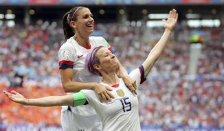FILE - In this July 7, 2019, file photo, United States' Megan Rapinoe, right, celebrates after scoring the opening goal from the penalty spot during the Women's World Cup final soccer match between U.S. and The Netherlands at the Stade de Lyon in Decines, outside Lyon, France. The members of the U.S. women's soccer team, with Rapinoe spearheading the move, brought their longstanding fight for equal pay to the fore during their march to the World Cup title this summer. (AP Photo/Francisco Seco, File)