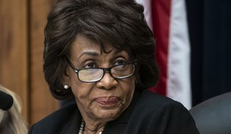 In this March 7, 2019, photo, House Financial Services Committee Chair Maxine Waters, D-Calif., leads a hearing to review the Consumer Financial Protection Bureau's mission to focus priority on consumers on Capitol Hill in Washington. On Friday, Sept. 27, 2019, The Associated Press reported on stories circulating online incorrectly asserting that Waters tweeted a profanity at President Donald Trump, accusing him of telling her she would need to take a urine test to prove her intelligence. The tweet originated on a parody account. (AP Photo/J. Scott Applewhite, File)