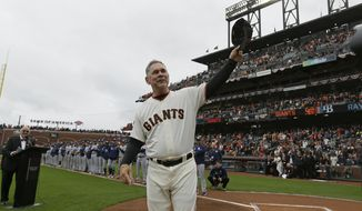 FILE - In this April 5, 2019, file photo, San Francisco Giants manager Bruce Bochy tips his cap to the crowd during introductions before the team's baseball game against the Tampa Bay Rays in San Francisco. Just as important to Bochy as capturing those three World Series titles in five years managing the Giants is his fairness and genuine way in dealing with the players who have helped him win during a decorated career on the dugout's top step. Everybody wants to do their best for the 64-year-old Bochy as he wraps up an accomplished 25-year managerial career that featured his first 12 seasons in San Diego and the last 13 with San Francisco. (AP Photo/Eric Risberg, File)