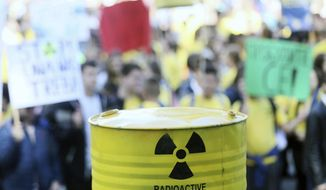Hundreds of Bosnians protest against plans by neighboring Croatia to store part of the waste from the region's only nuclear plant near its border with Bosnia, in the northwestern Bosnian town of Novi Grad, Friday, Sept. 27, 2019. The protesters Friday in the northwestern Bosnian town of Novi Grad warned that a nuclear waste facility would endanger the Una River and the lives of some 250,000 people living in the area. (AP Photo/Radivoje Pavicic)