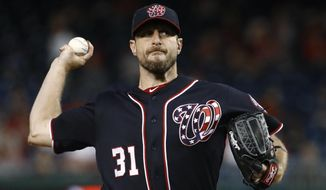 Washington Nationals starting pitcher Max Scherzer throws to the Atlanta Braves during the first inning of a baseball game Friday, Sept. 13, 2019, in Washington. (AP Photo/Patrick Semansky) ** FILE **