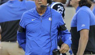 Duke head football coach David Cutcliffe looks toward the field at the start of an NCAA college football game against Virginia Tech, Friday, Sept. 27, 2019, in Blacksburg, Va. (Matt Gentry/The Roanoke Times via AP)