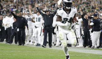 Philadelphia Eagles running back Jordan Howard runs for a touchdown after making a catch during the second half of the team's NFL football game against the Green Bay Packers on Thursday, Sept. 26, 2019, in Green Bay, Wis. (AP Photo/Jeffrey Phelps)