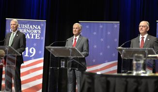 Gubernatorial candidates, from left, U.S. Rep. Ralph Abraham, Eddie Rispone, and Gov. John Bel Edwards, face each other in the second debate, hosted by Louisiana Public Broadcasting, on Thursday, Sept. 26, 2019, at Angelle Hall on the campus of the University of Louisiana at Lafayette in Lafayette, La.  (Brad Bowie /The Daily Advertiser via AP)