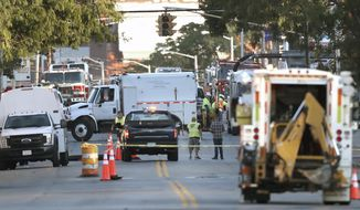 "Emergency personnel respond after a reported gas leak early Friday, Sept. 27, 2019 in Lawrence, Mass.   About 100 people have been evacuated from their homes and two schools have been closed in response to a natural gas leak in the Massachusetts city affected a year ago by a series of gas explosions and fires. Lawrence Fire Chief Brian Moriarty said the leak in a high-pressure line was discovered around 3:15 a.m. Friday and that the volume of gas released was in the ""explosive range."" No explosions or fires have been reported. (David L. Ryan/The Boston Globe via AP)"