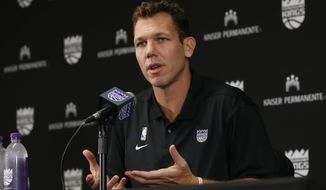 Sacramento Kings head coach Luke Walton responds to a question during a news conference at the team's media day in Sacramento, Calif., Friday, Sept. 27, 2019. The Kings will be leaving on Monday for India where they will play the Indiana Pacers in two preseason NBA basketball games. (AP Photo/Rich Pedroncelli)