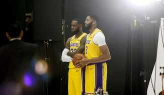 Los Angeles Lakers forwards LeBron James, center left, and Anthony Davis, center right, pose for photos during the NBA basketball team's media day in El Segundo, Calif., Friday, Sept. 27, 2019. (AP Photo/Ringo H.W. Chiu)