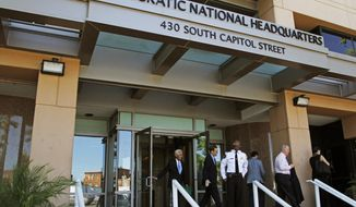 FILE - This Tuesday, June 14, 2016 file photo shows the entrance to the Democratic National Committee (DNC) headquarters in Washington. On Friday, Sept. 27, 2019, The Associated Press reported on stories circulating online incorrectly asserting that the FBI only relied on the word of a cybersecurity firm, CrowdStrike, to determine that Russia hacked the emails of the Democratic National Committee. CrowdStrike provided forensic evidence and analysis for the FBI to review during its investigation into a 2016 hack of DNC emails. (AP Photo/Paul Holston)