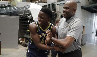 Indiana Pacers' Victor Oladipo jokes with head coach Nate McMillan during the NBA basketball team's media day, Friday, Sept. 27, 2019, in Indianapolis. (AP Photo/Darron Cummings)