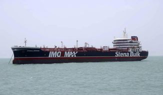 FILE - In this July 20, 2019, file photo, a British-flagged oil tanker Stena Impero which was seized by the Iran's Revolutionary Guard is photographed in the Iranian port of Bandar Abbas. The British-flagged oil tanker held by Iran since July began transmitted its location for the first time in weeks Friday, Sept. 27, 2019, ship-tracking website showed. (Tasnim News Agency via AP, File)