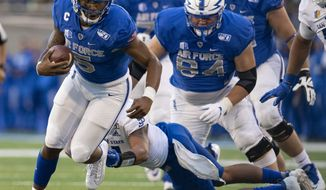 Air Force quarterback Donald Hammond III (5) runs down the field against San Jose State after replacing starting quarterback Isaiah Sanders during the first quarter of an NCAA college football game, Friday, Sept. 27, 2019, at Air Force Academy, Colo. (Christian Murdock/The Gazette via AP)