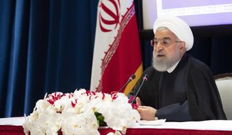 """Iran's President Hassan Rouhani speaks during a news conference, Thursday, Sept. 26, 2019, in New York.  Rouhani urged the United States on Thursday to """"cease this policy of maximum pressure"""" in favor of """"dialogue, and logic and reason."""" Rouhani's comments came one day after he accused Washington of engaging in """"international piracy"""" against Iran by re-imposing economic sanctions after the U.S. withdrew from the 2015 nuclear deal with world powers. (AP Photo/Mary Altaffer)"""