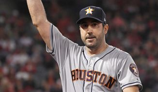 Houston Astros starting pitcher Justin Verlander waves to fans as he walks back to the dugout after striking out Los Angeles Angels' Kole Calhoun for his 3,000th career strikeout during the fourth inning of a baseball game Saturday, Sept. 28, 2019, in Anaheim, Calif. (AP Photo/Mark J. Terrill)