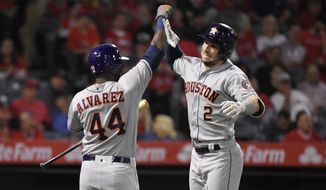 Houston Astros' Alex Bregman, right, is congratulated by Yordan Alvarez after hitting a solo home run during the second inning of a baseball game against the Los Angeles Angels, Friday, Sept. 27, 2019, in Anaheim, Calif. (AP Photo/Mark J. Terrill)