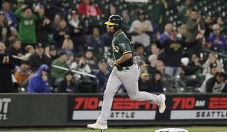 Oakland Athletics' Marcus Semien rounds the bases after hitting a solo home run during the first inning of a baseball game against the Seattle Mariners, Friday, Sept. 27, 2019, in Seattle. (AP Photo/Ted S. Warren)