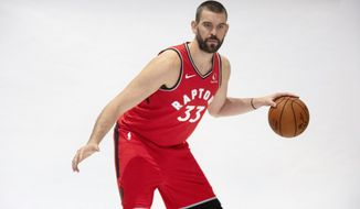 Toronto Raptors' Marc Gasol poses during a photo shoot at the Raptors Media day in Toronto, Saturday, Sept. 28, 2018. . (Chris Young/The Canadian Press via AP)