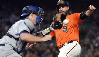 San Francisco Giants' Brandon Belt (9) beats the tag by Los Angeles Dodgers catcher Will Smith, left, on a sacrifice fly by Kevin Pillar during the third inning of a baseball game Friday, Sept. 27, 2019, in San Francisco. (AP Photo/Tony Avelar)