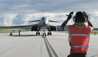 FILE - In this file photo provided by the U.S.Air Force, taken July 26, 2017, a U.S. Air Force B-1B Lancer arrives at Andersen Air Force Base, Guam. President Donald Trump is raising a large chunk of the money for his border wall with Mexico by deferring several large military construction projects slated for the strategically important Pacific outpost of Guam. This may disrupt plans to move Marines to Guam from Japan and to modernize important munitions storage for the Air Force. About 7% of the funds for the $3.6 billion wall are being diverted from eight projects in U.S. territory. (U.S. Air Force by Tech. Sgt. Richard P. Ebensberger via The AP, File)