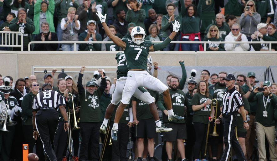 Michigan State's Cody White (7) and Darrell Stewart celebrate Stewart's touchdown reception against Indiana during the second quarter of an NCAA college football game, Saturday, Sept. 28, 2019, in East Lansing, Mich. (AP Photo/Al Goldis)