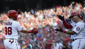 Washington Nationals' Gerardo Parra (88) celebrates his grand slam with Asdrubal Cabrera, right, during the second inning of a baseball game against the Cleveland Indians, Saturday, Sept. 28, 2019, in Washington. (AP Photo/Nick Wass) ** FILE **