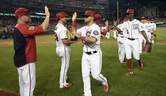Washington Nationals' Gerardo Parra, third from left, and others celebrate after a baseball game against the Cleveland Indians, Saturday, Sept. 28, 2019, in Washington. (AP Photo/Nick Wass)
