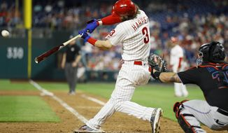 Philadelphia Phillies' Bryce Harper (3) hits a three-run home run off Miami Marlins relief pitcher Wei-Yin Chen during the sixth inning of a baseball game, Saturday, Sept. 28, 2019, in Philadelphia. (AP Photo/Matt Slocum)