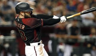 Arizona Diamondbacks' Christian Walker follows through on his swing as he hits a grand slam home run against the San Diego Padres during the seventh inning of a baseball game, Saturday, Sept. 28, 2019, in Phoenix. (AP Photo/Ralph Freso)