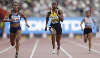 Orlann Ombissa-Dzangue, of France, and Elaine Thompson, of Jamaica, compete in a women's 100 meter heat at the World Athletics Championships in Doha, Qatar, Saturday, Sept. 28, 2019. (AP Photo/Petr David Josek)
