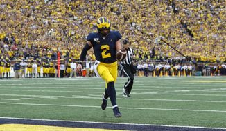 Michigan quarterback Shea Patterson (2) scores on a two-yard touchdown run in the first half of an NCAA college football game against Rutgers in Ann Arbor, Mich., Saturday, Sept. 28, 2019. (AP Photo/Paul Sancya)